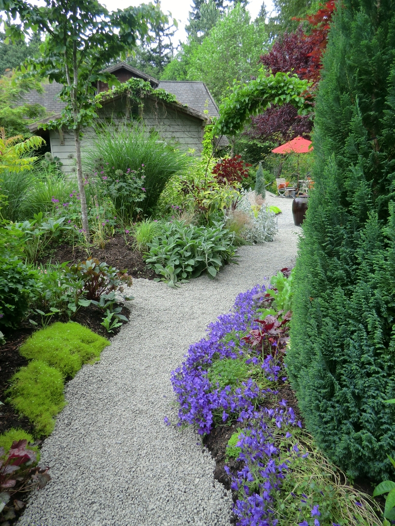Here's another view. There are very few contrasts, and too many dark plants for such a shady area.